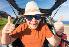 Funny happy man going on summer vacation. Car travel concept Royalty Free Stock Photos