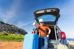 Funny happy man going on summer vacation. Car travel concept Royalty Free Stock Photo