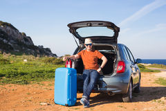 Funny happy man going on summer vacation. Car travel concept Stock Images