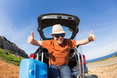 Funny happy man going on summer vacation. Car travel concept Royalty Free Stock Photography