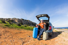 Funny happy man going on summer vacation. Car travel concept Stock Image