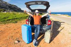 Funny happy man going on summer vacation. Car travel concept Stock Photo