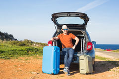 Funny happy man going on summer vacation. Car travel concept Royalty Free Stock Image