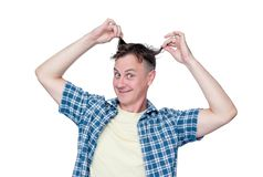 Funny happy man in a plaid shirt holds his hair, isolated on white background royalty free stock photo