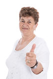 Funny happy older woman isolated with thumb up. Royalty Free Stock Photography