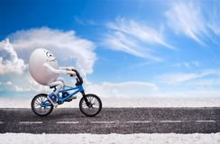 Funny happy smiling egg is riding by the road Stock Photos
