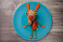 Funny hare made of vegetables Stock Images