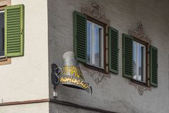 2ace162e41b Funny hat sign St. Johann in Tirol Austria. Funny hatmakers sign on a corner