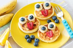 Funny Healthy Breakfast For Kids. Colorful Children Food Menu. On Yellow Plate royalty free stock photo