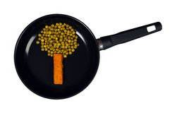 Funny healthy vegetables on a frying pan Royalty Free Stock Photos