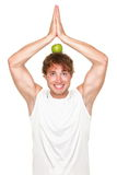 Funny healthy yoga fitness man eating Stock Photo