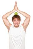 Funny healthy yoga fitness man eating stock photo