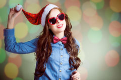 Funny hipster girl in heart shaped sunglasses and Stock Photo