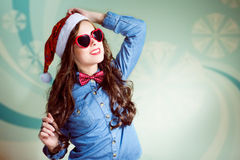 Funny hipster girl in heartshape sunglasses Royalty Free Stock Photo