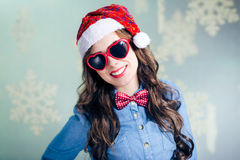 Funny hipster girl in heartshape sunglasses Royalty Free Stock Images