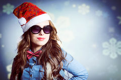 Funny hipster girl in sunglasses wearing xmas Stock Photos