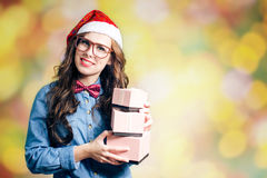 Funny hipster girl in xmas santa hat Stock Images