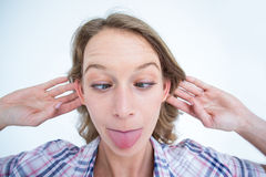 Funny hipster grimacing Stock Photography