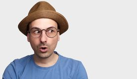 Funny hipster isolated on grey background royalty free stock photo