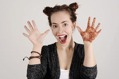 Funny hipster woman is shouting with an opened mouth and hands up. Stock Images