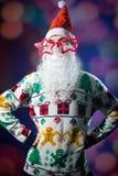 Funny hipster young man wearing Santa beard and Stock Image