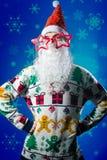 Funny hipster young man wearing Santa beard and Stock Photos