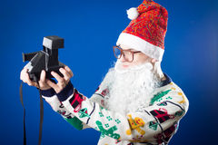 Funny hipster young man wearing Santa Clous beard Stock Images