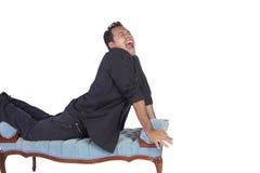 Funny Hispanic Man Posing on Chair Royalty Free Stock Image