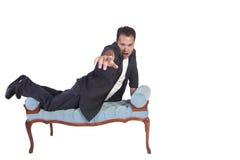 Funny Hispanic Man Posing on Chair Stock Photography
