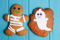 Funny homemade Halloween ginger cookies with ghost and mummy on. Bright blue background, close up. Halloween sweets, homemade confectionery, holiday food Royalty Free Stock Image