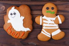 Funny homemade Halloween ginger cookies with ghost and mummy, cl royalty free stock photo