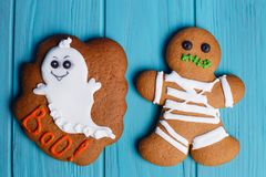 Funny homemade Halloween ginger cookies with ghost and mummy on. Bright background, close up. Halloween sweets, homemade confectionery, holiday food Stock Photo