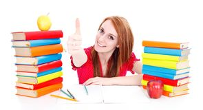 Funny homework moments with books and apples Stock Photo