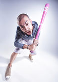 Funny hooligan with a pink baseball bat screaming in the studio Royalty Free Stock Photography