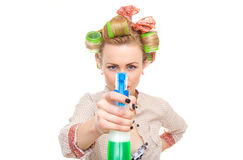 Funny housewife. / woman spraying the cleaner on you, isolated on white. Glass or window cleaner Royalty Free Stock Photos
