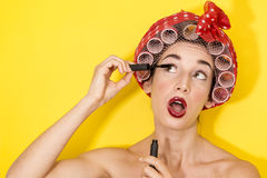 Funny housewife applying makeup Stock Image