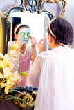 Funny housewife beauty green clay mask Stock Images