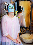 Funny housewife beauty green clay mask Royalty Free Stock Photo
