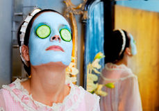 Funny housewife beauty green clay mask Stock Image