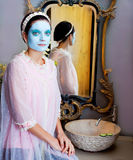 Funny housewife beauty treatment green clay mask Stock Photo