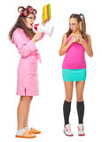 Funny housewife with books and megaphone screams to girl Stock Image