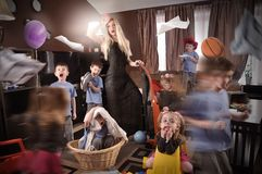 Funny Housewife Cleanning House with Children Royalty Free Stock Photo