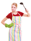 Funny housewife or cook chef in colorful kitchen apron with ladle Stock Photography
