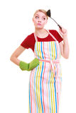 Funny housewife or cook chef in colorful kitchen apron with ladle Stock Photos