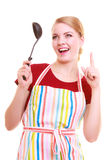 Funny housewife or cook chef in colorful kitchen apron with ladle Royalty Free Stock Image