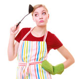 Funny housewife or cook chef in colorful kitchen apron with ladle Royalty Free Stock Images