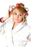 Funny housewife with curlers Stock Images