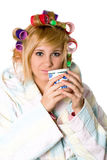 Funny housewife with curlers and cup Royalty Free Stock Images