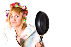 Funny housewife with curlers and pan Royalty Free Stock Photography