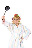 Funny housewife with curlers and skimmer Stock Photography